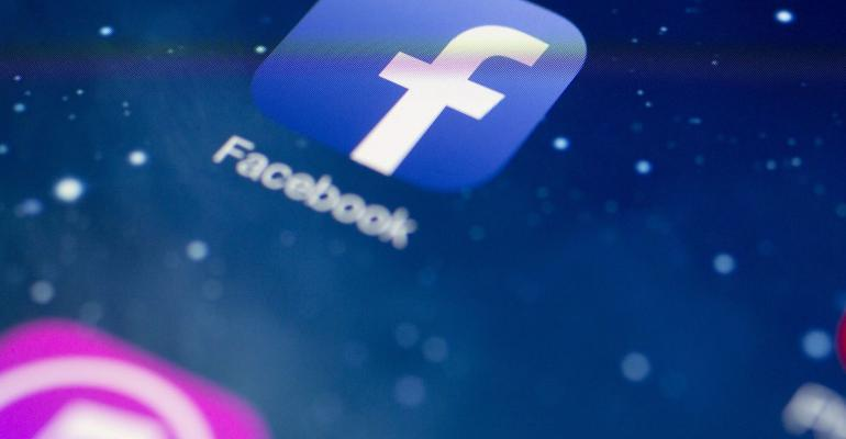 The Facebook Inc. application icon is seen on an Apple Inc. iPad Air in this arranged photograph in Washington, D.C., U.S. Photographer: Andrew Harrer