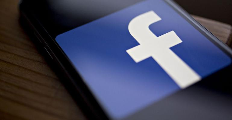 The Facebook Inc. logo is displayed for a photograph on an Apple Inc. iPhone in Washington, D.C., U.S., on Wednesday, March 21, 2018. Facebook is struggling to respond to growing demands from Washington to explain how the personal data of millions of its users could be exploited by a consulting firm that helped Donald Trump win the presidency. Photographer: Andrew Harrer/Bloomberg