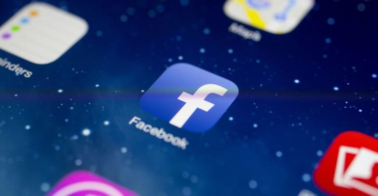 The Facebook Inc. application icon is seen on an Apple Inc. iPad Air in this arranged photograph in Washington, D.C., U.S. Photographer: Andrew Harrer/Bloomberg