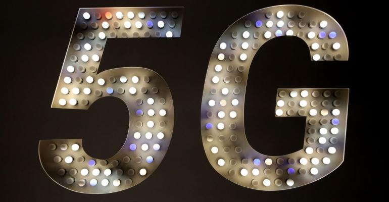 A 5G sign illuminated by light bulbs stands on the Xiaomi Corp. stand on the opening day of the MWC Barcelona in Barcelona, Spain. Photographer: Angel Garcia/Bloomberg