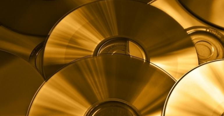 Gold CDs as background