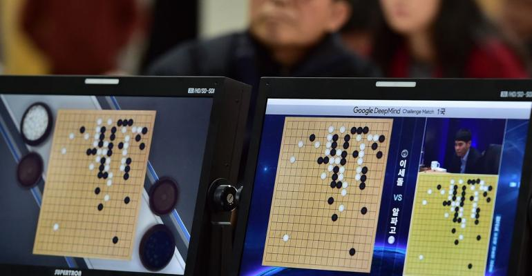 South Korean Go game fans watch a television screen broadcasting live footage of the Google DeepMind Challenge Match, at the Korea Baduk Association in Seoul. Photographer: Jung Yeon-Je/AFP/Getty Images
