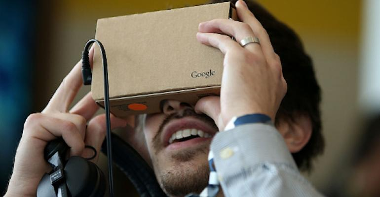 Person looking through Google cardboard device