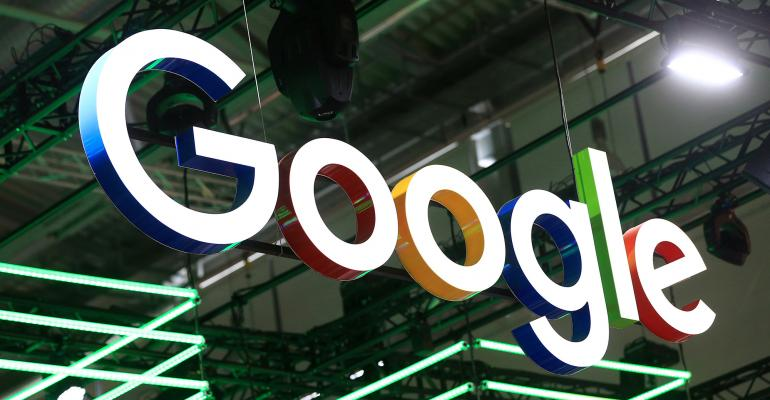 The Google Inc. logo hangs illuminated over the company's exhibition stand at the Dmexco digital marketing conference in Cologne, Germany. Photographer: Krisztian Bocsi/Bloomberg