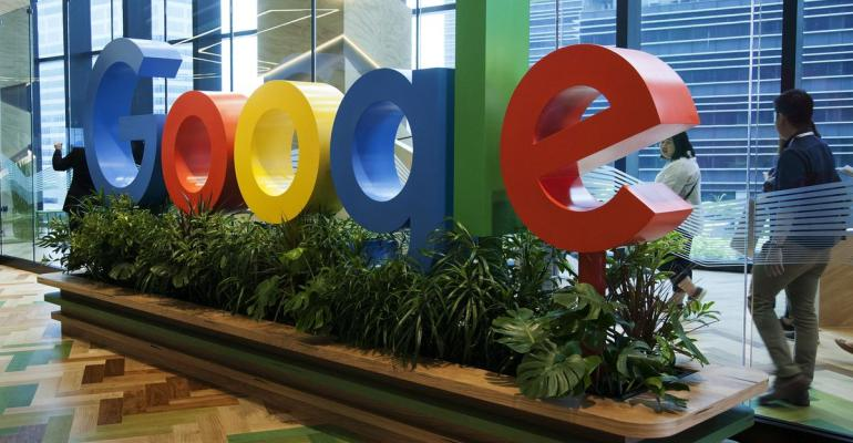 A sign featuring Google Inc.'s logo stands at the company's Asia-Pacific headquarters during its opening day in Singapore, on Thursday, Nov. 10, 2016. Photographer: Ore Huiying/Bloomberg