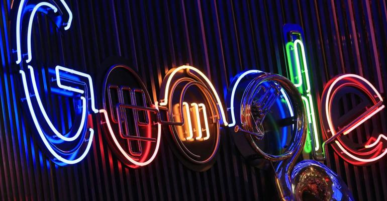 The Google Inc. logo hangs illuminated at the company's exhibition stand at the Dmexco digital marketing conference in Cologne, Germany. Photographer: Krisztian Bocsi