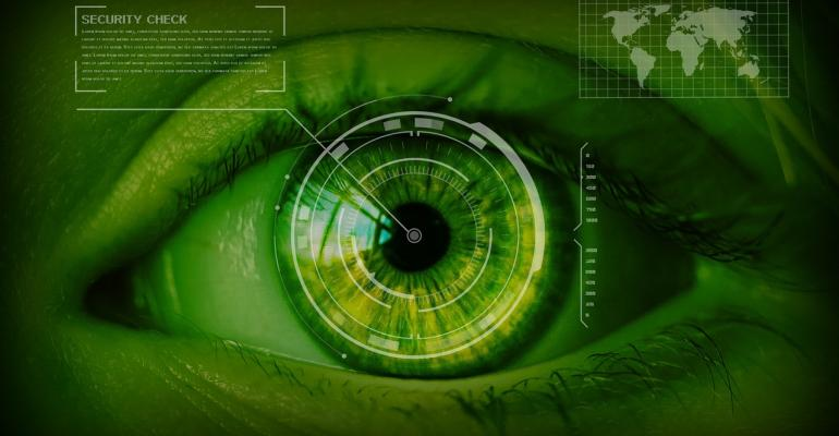 An green tinted image with an eye and global map for security checks
