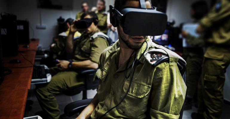 An Israeli Army solider uses a Oculus virtual reality headset for training