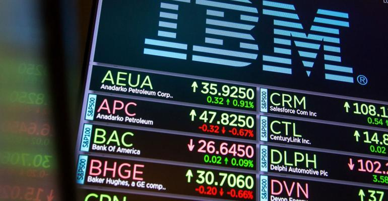 A monitor displays International Business Machines Corp. (IBM) signage on the floor of the New York Stock Exchange (NYSE) in New York, U.S., on Monday, Nov. 20, 2017. The main U.S. equity gauge moved just a 10th of a percent last week, but investor hedging has jumped to a six-year high. Photographer: Michael Nagle/Bloomberg