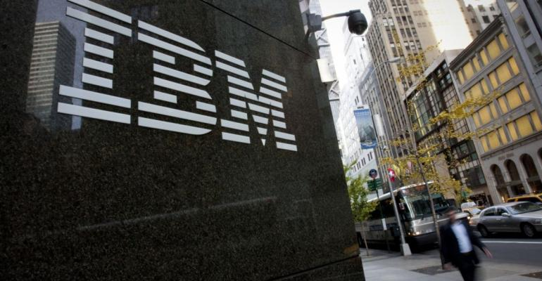 Pedestrians walk past International Business Machines Corp. (IBM) offices in New York, U.S., on Monday, Nov. 14, 2011. Photographer: Scott Eells