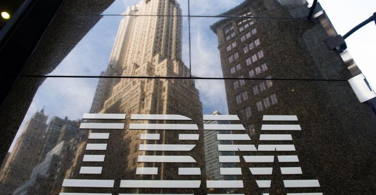 The International Business Machines Corp. (IBM) logo is displayed in front of the company's offices in New York, U.S., on Monday, Oct. 14, 2013.  Photographer: Craig Warga/Bloomberg