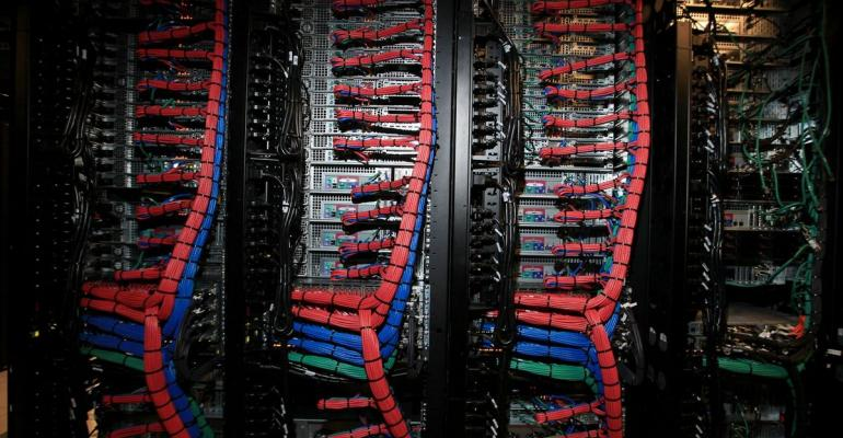 Public, private, and management data wires lead to servers on one of the cloud racks inside pod two of International Business Machines Corp.'s (IBM) Softlayer data center in Dallas, Texas, U.S. Photographer: Ben Torres/Bloomberg