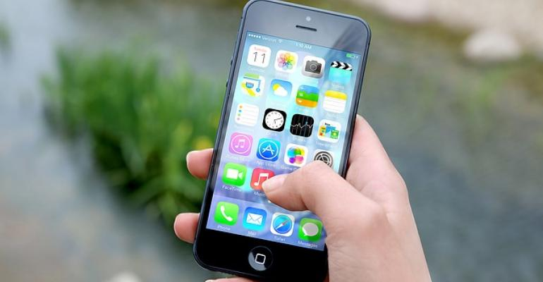 This is a human hand holding an iPhone.