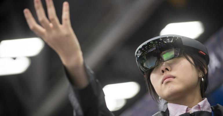 An attendee wears a Microsoft Corp. HoloLens headset at the South By Southwest (SXSW) conference in Austin, Texas, U.S., on Tuesday, March 13, 2018.  Photographer: David Paul Morris/Bloomberg