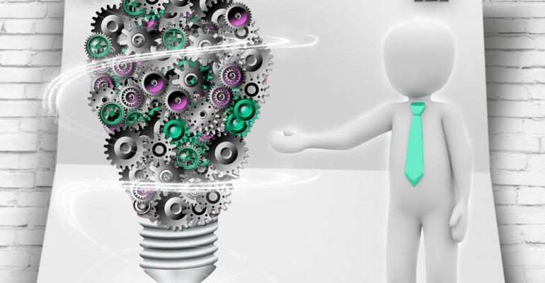 A managerial figure points at a lightbulb made of gears, implying that all ideas need smoothly working processes to really light up.