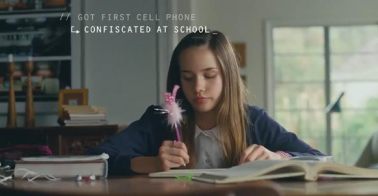 An image of a young girl doing homework and writing with a purple pen