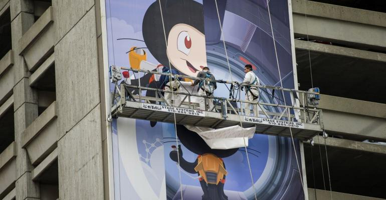 Workers install a billboard for GitHub Inc. in San Francisco, California, U.S., on Tuesday, Nov. 11, 2014.  Photographer: David Paul Morris/Bloomberg