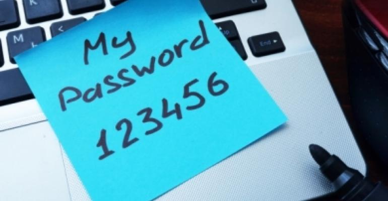 "Laptop with ""My Password is 123456"" on a Sticky Note"