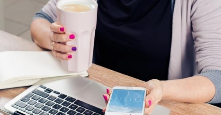 Woman at Office Desk with Laptop and Coffee