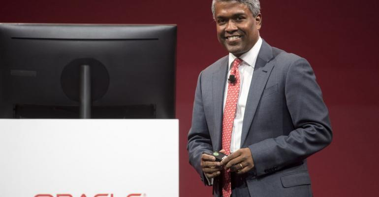 Thomas Kurian, president of product development at Oracle Corp., smiles during the Oracle OpenWorld 2017 conference in San Francisco, California, U.S., on Tuesday, Oct. 3, 2017. Oracle Corp. plans to pay its leaders more than $100 million each in fiscal 2018, an increase of about 150 percent, as it rips a page from Tesla Inc.'s playbook to change its executive-compensation practices in response to investor complaints. Photographer: David Paul Morris/Bloomberg