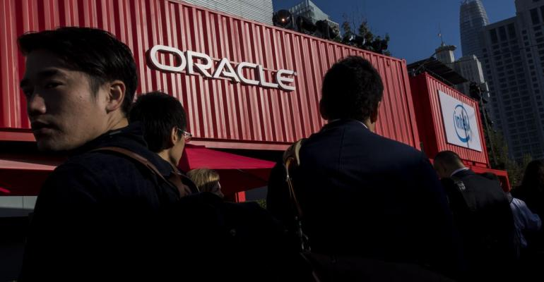Attendees wait in line to enter the Moscone Center North building during the Oracle OpenWorld 2017 conference in San Francisco, California, U.S. Photographer: David Paul Morris/Bloomberg