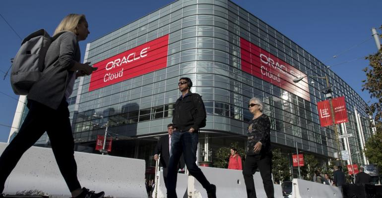Pedestrians walk in front of the Moscone Center West during the Oracle OpenWorld 2017 conference in San Francisco, California, U.S., on Tuesday, Oct. 3, 2017.  Photographer: David Paul Morris/Bloomberg