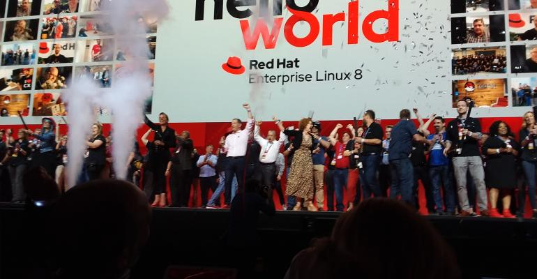 Stage full of people celebrating launch of RHEL 8 at Red Hat Summit 2019