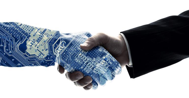 robot shaking a man's hand