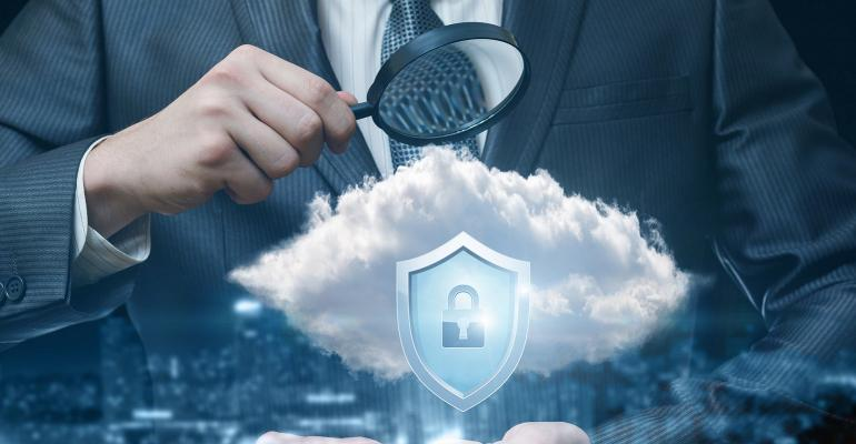 looking through a magnifying glass on cloud security