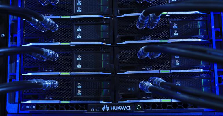 Blue light illuminates cables on an E9000 blade server rack, manufactured by Huawei Technologies Co. Ltd., at the CeBIT 2017 tech fair in Hannover, Germany, on Monday, March 20, 2017. Photographer: Krisztian Bocsi/Bloomberg