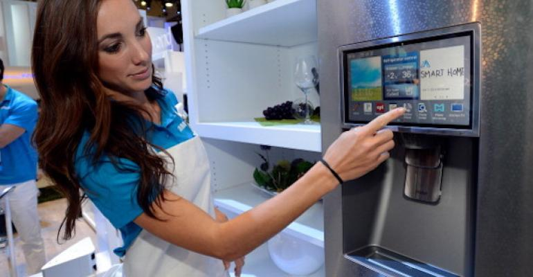 A Samsing employee demonstrates how the screens work on an Internet-connected fridge.