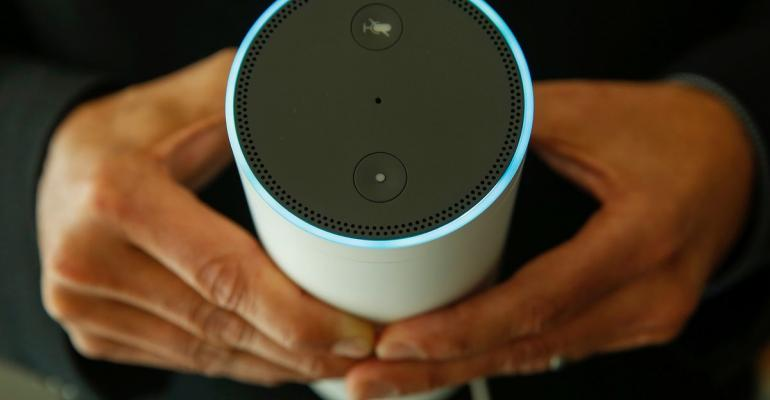 Closeup of a person holding a smart home device