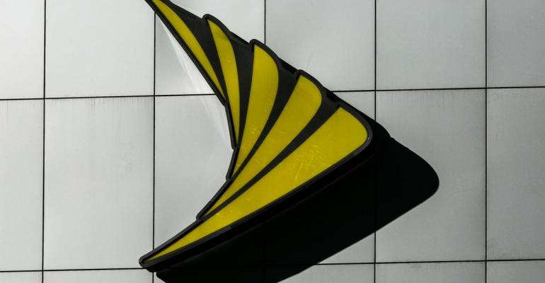 A Sprint Corp. logo is displayed on the exterior of a store location in New York, U.S. Photographer: Jeenah Moon/Bloomberg