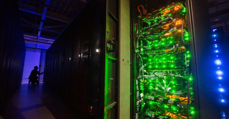 Lights illuminate data racks in the server hall of the Sberbank PJSC data processing center (DPC) at the Skolkovo Innovation Center, in Moscow, Russia, on Tuesday, Dec. 26, 2017. Sberbank PJSC, Russia's most valuable company, will boost its dividend payout to 50 percent of profit or higher, just not as quickly as some investors had hoped. Photographer: Andrey Rudakov/Bloomberg