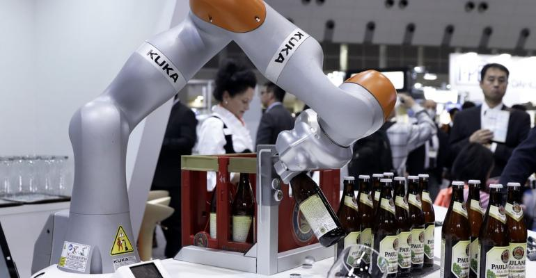 A Kuka AG LBR iiwa robotic arm opens a bottle of beer during a demonstration at the International Robot Exhibition in Tokyo, Japan, on Wednesday, Nov. 29, 2017. The expo runs through Dec. 2. Photographer: Kiyoshi Ota/Bloomberg