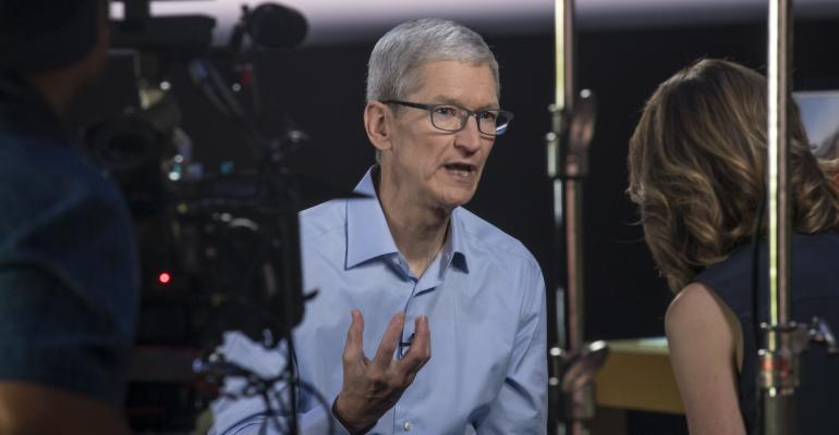 Tim Cook talking to the press