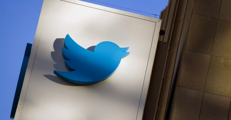 The Twitter Inc. logo is displayed on the facade of the company's headquarters in San Francisco, California, U.S. Photographer: David Paul Morris/Bloomberg