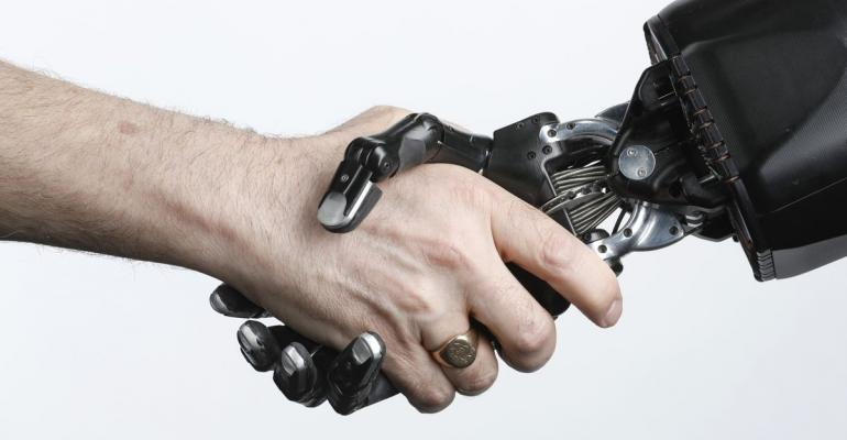 A robotic hand grips a human hand in a 'Handshake' motion, a gesture indicating a greeting during a demonstration of its agility in an arranged photograph in London, on Wednesday, Feb. 14, 2018.  Photographer: Luke MacGregor/Bloomberg