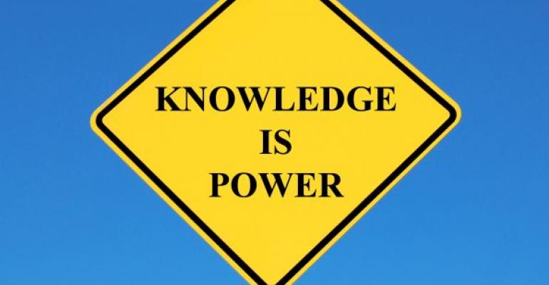 yellow road sign reading KNOWLEDGE IS POWER blue background