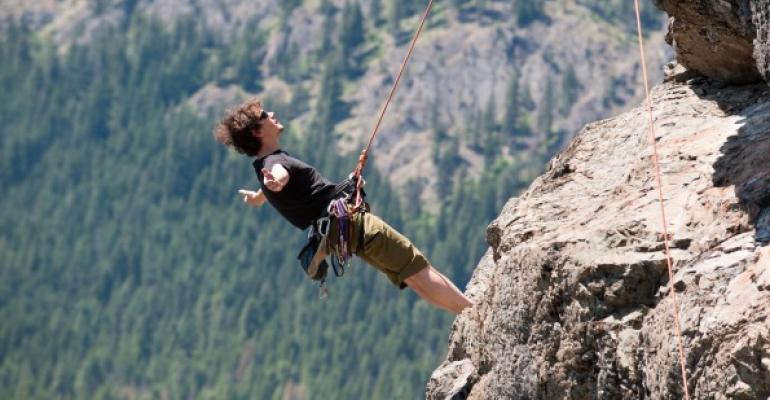 Man climbing a rocky precipice