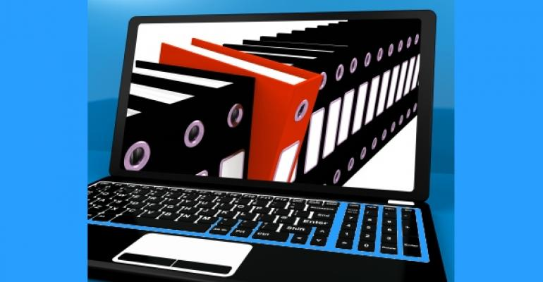 laptop screen showing a line of black folders with one red folder