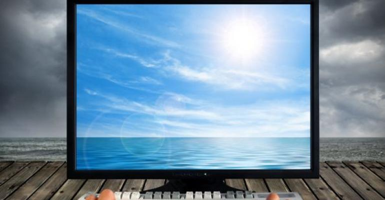 computer screen showing blue sky and ocean