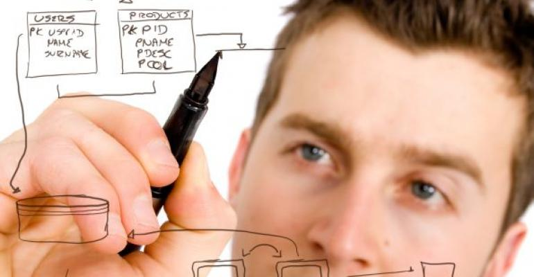 man drawing a database design flowchart