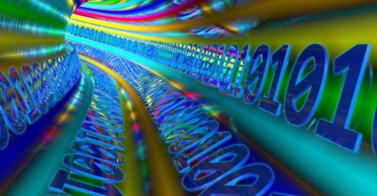 multicolored tunnel curving to the left lined with binary