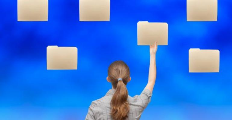 woman reaching for folders in the sky