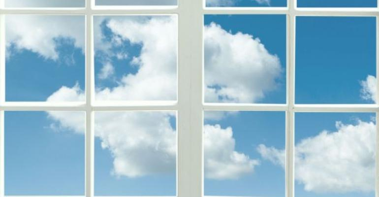 windows with white framing blue sky with clouds visible