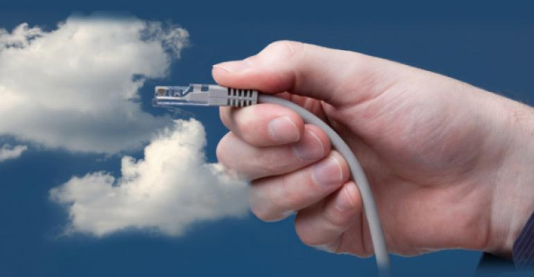 hand plugging an ethernet cord into a cloud