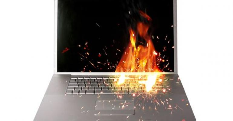 laptop with fire flames on keyboard