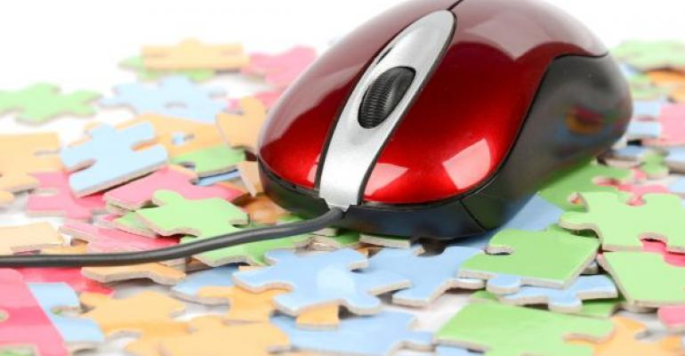 Red computer mouse sitting on jigsaw puzzle pieces