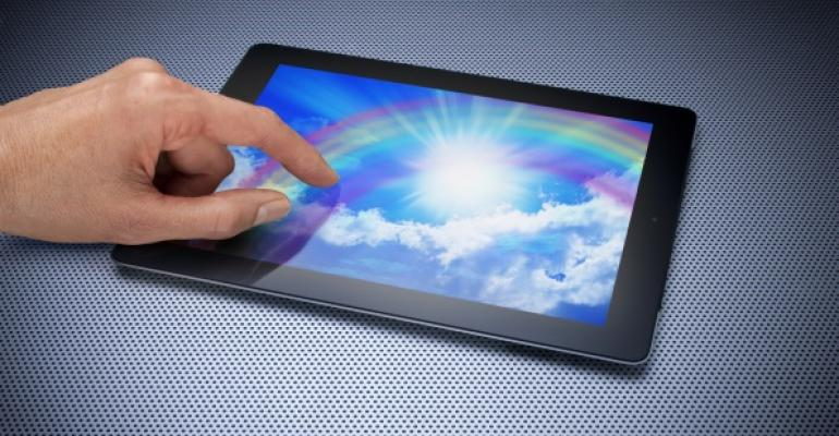 hand with pointer finger touching screen of digital tablet